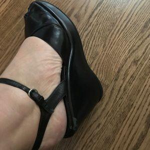 Miu Miu black leather platforms.